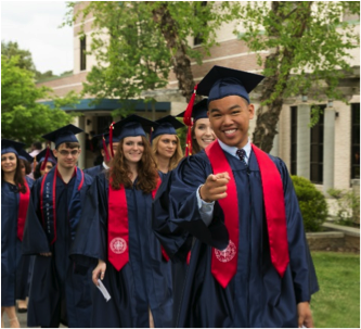 Students smiling during grad walk