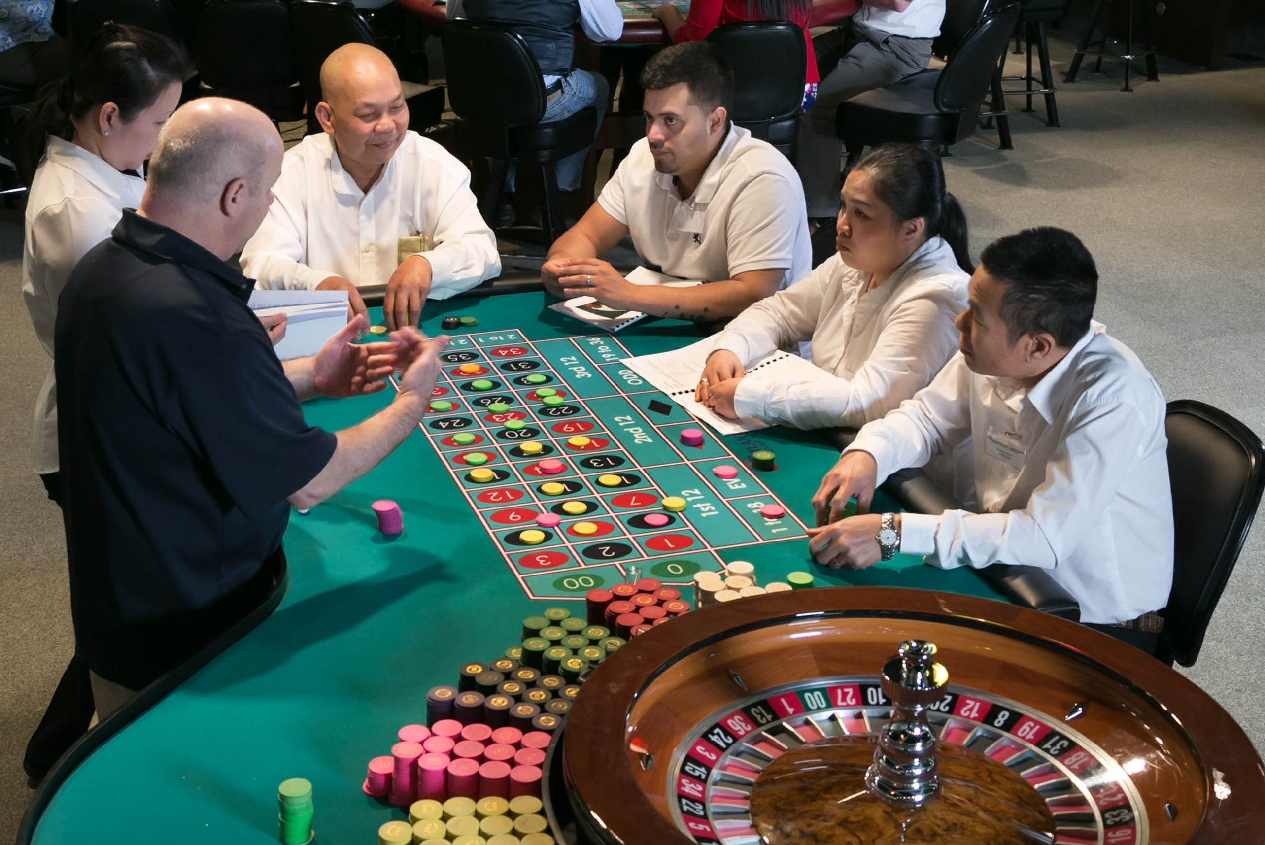 students at roulette table