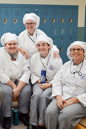 group of culinary students in their uniforms