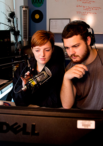 picture of two students in the radio station recording a broadcast