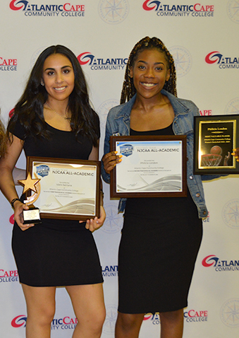 2 female athletes with academic awards